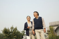 Senior couple going for a stroll in Beijing, holding hands Royalty Free Stock Photography