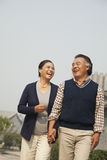 Senior couple going for a stroll in Beijing, holding hands Stock Photo