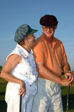 Senior couple golf royalty free stock photo