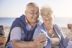 Senior couple. Good moods because of best wine Stock Images