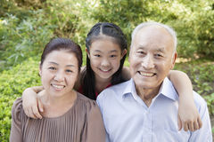 Senior Couple with Granddaughter Stock Images