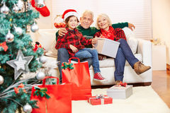 Senior couple and grandson celebrating christmas Royalty Free Stock Photography