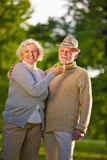 Senior couple with green apple in garden Royalty Free Stock Image