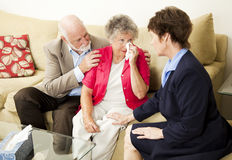 Senior Couple Grief Counseling. Senior couple sees a therapist to cope with grief.  Could also be funeral director meeting with clients Stock Photo