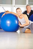 Senior couple with gym ball in fitness center Stock Photography