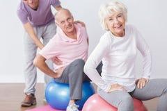 Senior couple on gym Stock Photos