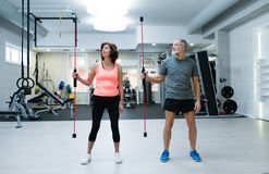 Senior couple in gym working out with vibration bars Royalty Free Stock Image