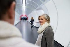 Senior couple in hallway of subway saying goodbye Stock Photo