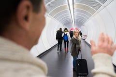 Senior couple in hallway of subway saying goodbye Royalty Free Stock Image
