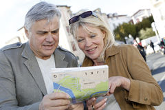 Senior couple hanging out in town looking at map Royalty Free Stock Images