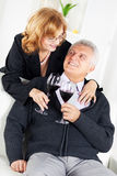 Senior couple. Happy Senior couple in home interior enjoying in glass of wine Stock Photography