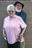 Senior couple happy with life. Senior man with his hands on the hips of his wife royalty free stock images