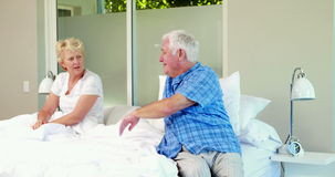Senior couple having an argument. On bed stock video footage