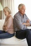 Senior Couple Having Argument At Home Stock Image
