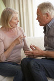 Senior Couple Having Argument At Home Royalty Free Stock Photography