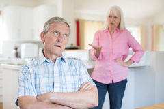 Senior Couple Having Argument At Home. Unhappy Senior Couple Having Argument At Home royalty free stock photos