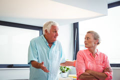 Senior couple having an argument. In a retirement home stock photography