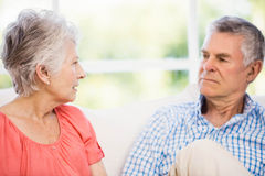 Senior couple having argument on the sofa Royalty Free Stock Photos