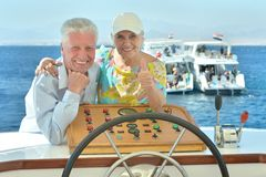 Senior couple having boat ride Stock Photo