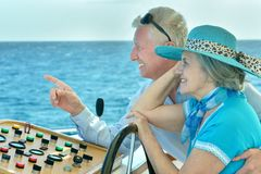 Senior couple having boat ride Royalty Free Stock Images