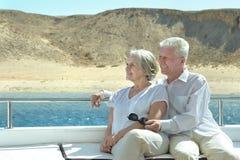 Senior couple having boat ride Stock Photos