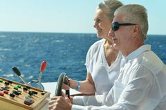 Senior couple having boat ride stock photos