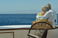 Senior couple having boat ride Royalty Free Stock Images