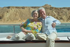 Senior couple having boat ride Stock Image