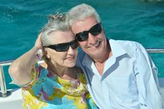 Senior couple having boat ride Royalty Free Stock Image