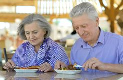 Senior couple having breakfast Royalty Free Stock Photo