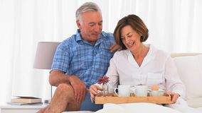 Senior couple having  breakfast together Royalty Free Stock Image