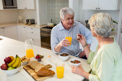 Senior couple having breakfast together Stock Images