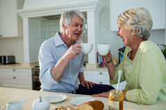 Senior couple having coffee at dining table Royalty Free Stock Photography