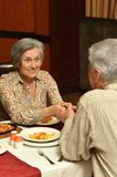 Senior couple having a dinner Stock Photos