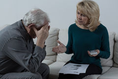 Senior couple having financial troubles Stock Images