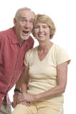 Senior couple having fun. Lively senior couple messing about. White background royalty free stock images