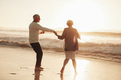 Senior couple having fun at beach Stock Photos