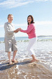 Senior Couple Having Fun On Beach Holiday Royalty Free Stock Photography