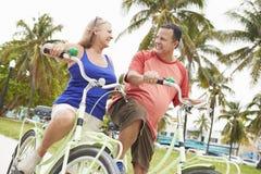 Senior Couple Having Fun On Bicycle Ride Royalty Free Stock Image