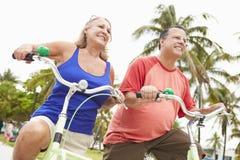 Senior Couple Having Fun On Bicycle Ride Royalty Free Stock Images