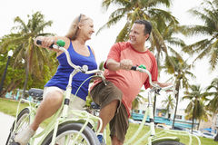 Senior Couple Having Fun On Bicycle Ride Stock Photography