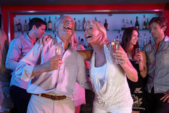 Senior Couple Having Fun In Busy Bar Royalty Free Stock Image