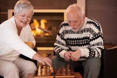 Senior couple having fun with chess Stock Image