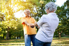Senior couple having fun and dance in the park Stock Photography