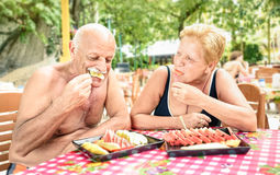 Senior Couple Having Fun Eating Season Fruit In Thai Restaurant Royalty Free Stock Photography