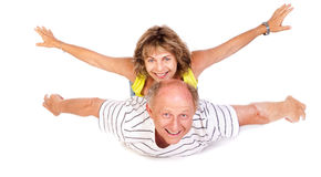 Senior couple having fun, indoors Stock Photos