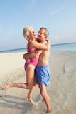 Senior Couple Having Fun On Tropical Beach Holiday Royalty Free Stock Photos