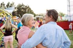 Senior couple having a good time at the fun fair Royalty Free Stock Image