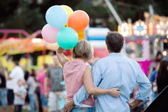 Senior couple having a good time at the fun fair Stock Image