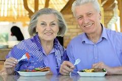 Senior couple having lunch Stock Photo